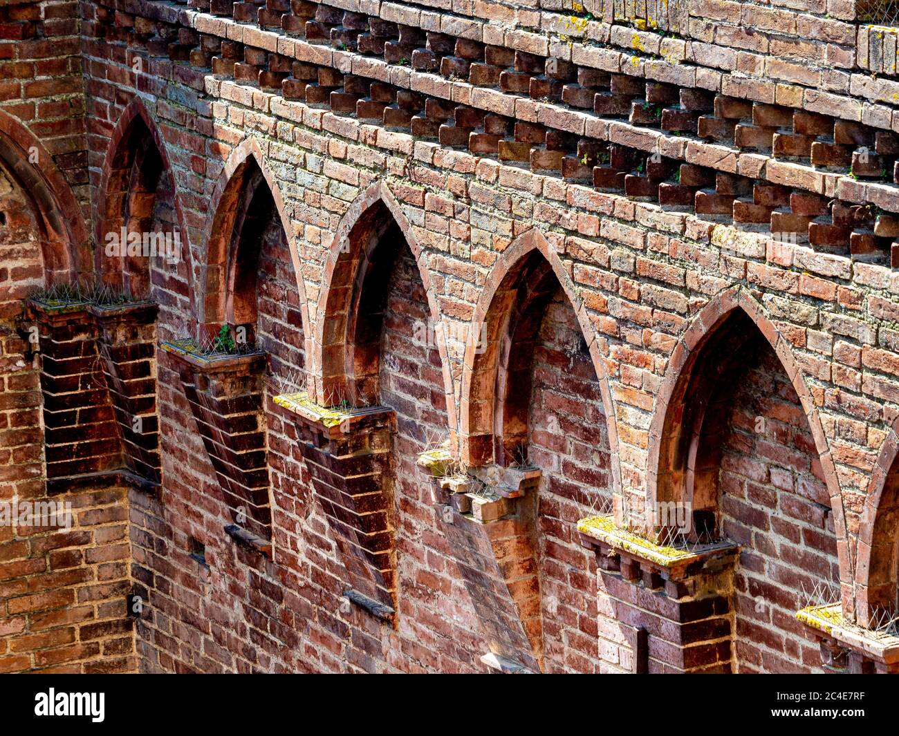 Close up of the brickwork on the Palazzo Pubblico seen from the Torre del mangia. Siena. Italy. Stock Photo