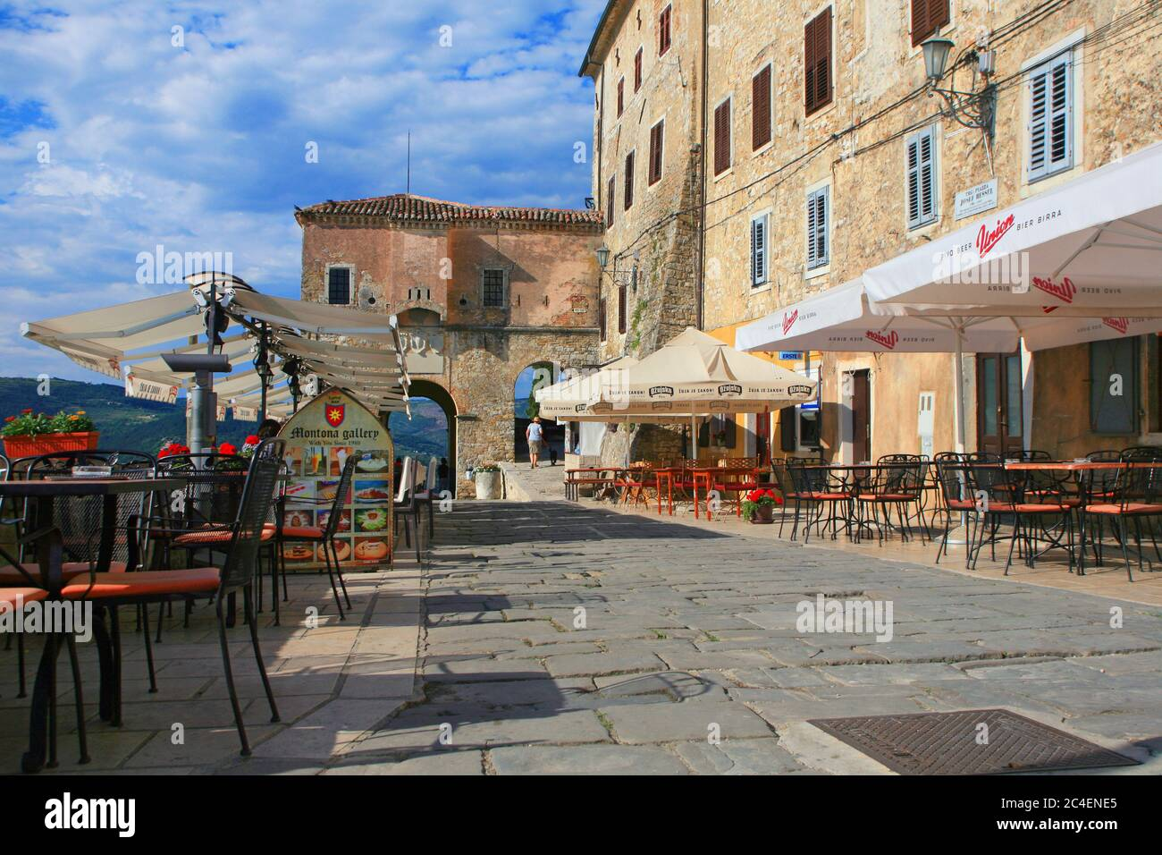 MOTOVUN, CROATIA - SEPTEMBER 15, 2011: The old town wall with the city gate and coffee bars in Motovun in Istria Stock Photo