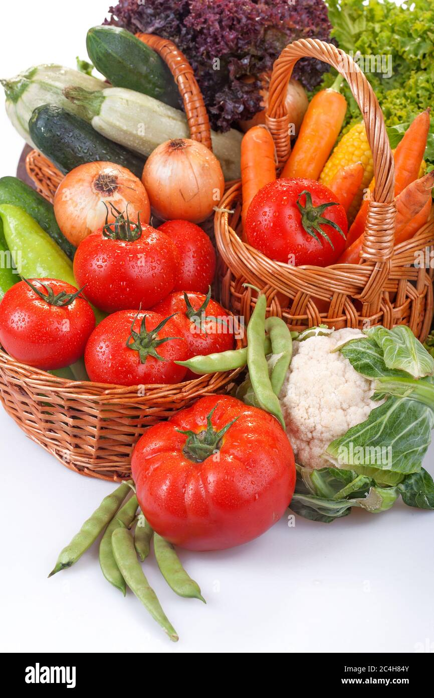 Freshly picked organic vegetables. Baskets with vegetables as the concept of biological, bioproducts, bio ecology, from the home garden healthy food. Stock Photo