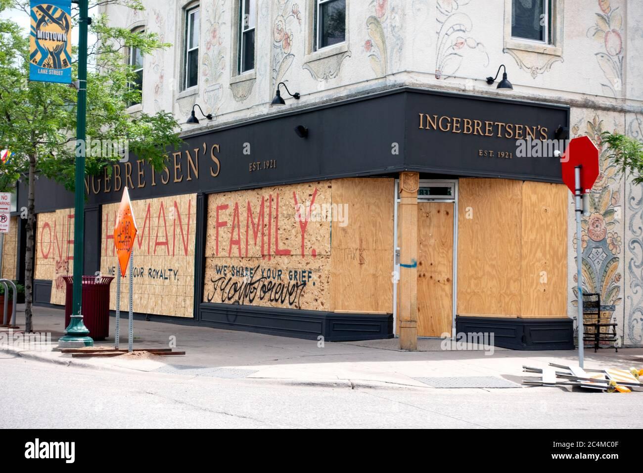 "Ingebretsen's store on Lake Street boarded up saying ""One Human Family"" Minneapolis Minnesota MN USA Stock Photo"