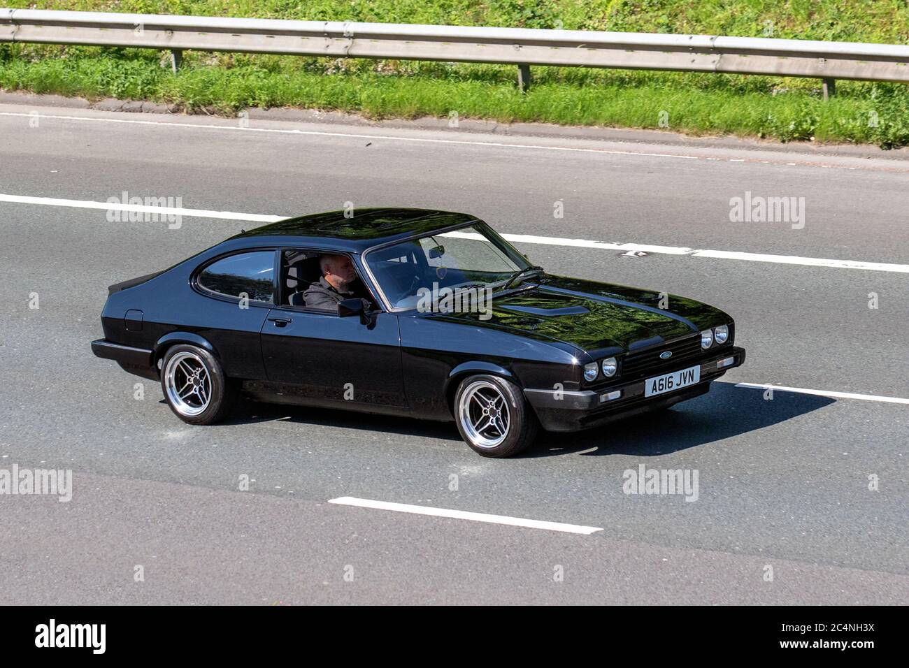 A616jvn 1984 Black Ford Capri Ls 5spd Classic Sports Cars Cherished Veteran Restored Old Timer Collectible Motors Vintage Heritage Old Preserved Collectable Vehicular Traffic Moving Vehicles Cars Driving Vehicle On Uk Roads