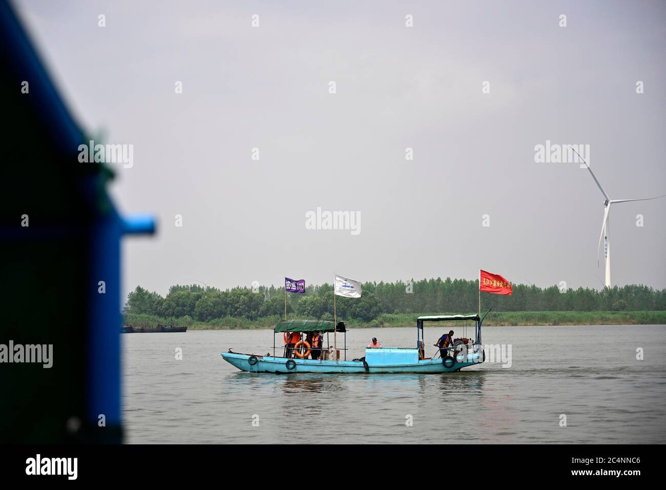 (200628) -- NANCHANG, June 28, 2020 (Xinhua) -- Members of a Yangtze finless porpoise protection team take part in a patrol mission on the Poyang Lake in Hukou County, east China's Jiangxi Province, June 8, 2020. Eight of the 11 team members are fishermen-turned finless porpoise protectors who patrol the Poyang Lake on a daily basis. Their missions include dismantling illegal fishing facilities and preventing unlawful activities that damage the Poyang Lake's fisheries resources. China began a 10-year fishing moratorium from the beginning of this year in 332 conservation areas in the Yangtze Ri Stock Photo