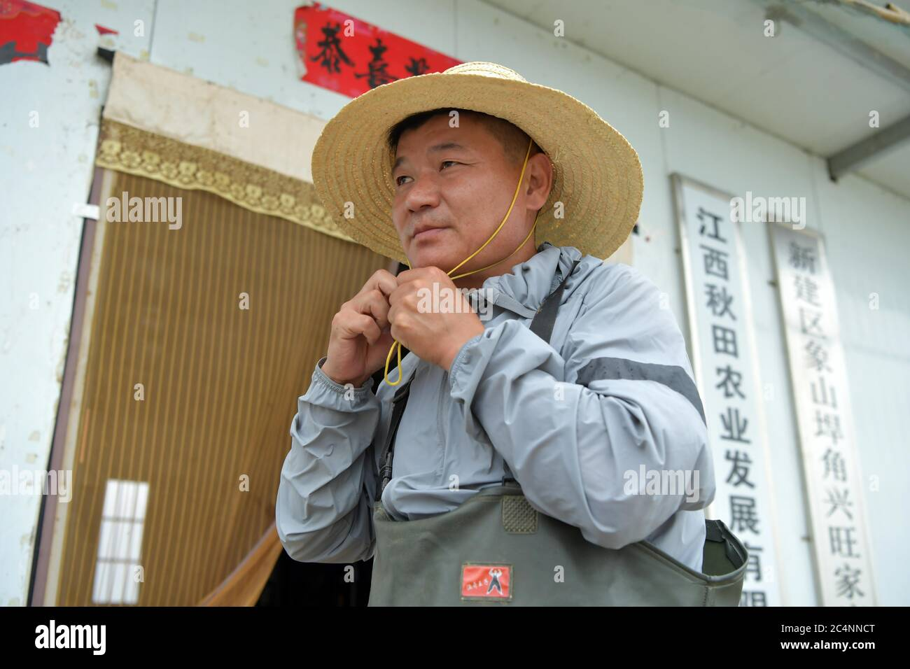 (200628) -- NANCHANG, June 28, 2020 (Xinhua) -- Wu Huashan wears an outfit to harvest crayfish in Xiangshan Township of Nanchang, east China's Jiangxi Province, June 5, 2020. Having learned fishing at an early age with his parents, Wu was a skilled fisherman and was head of a local fishery association. In late 2019, he bade farewell to his boats and started a crayfish business. China began a 10-year fishing moratorium from the beginning of this year in 332 conservation areas in the Yangtze River basin, which will be expanded to all the natural waterways of the country's longest river and its m Stock Photo