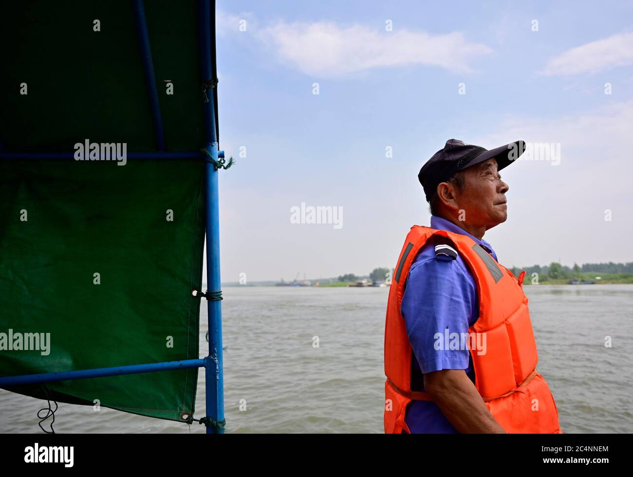 (200628) -- NANCHANG, June 28, 2020 (Xinhua) -- Wu Houchun, an ex-fisherman who works at a Yangtze finless porpoise protection team, takes part in a patrol mission on Poyang Lake in Hukou County, east China's Jiangxi Province, June 8, 2020. Eight of the 11 team members are fishermen-turned finless porpoise protectors who patrol the Poyang Lake on a daily basis. Their missions include dismantling illegal fishing facilities and preventing unlawful activities that damage the Poyang Lake's fisheries resources. China began a 10-year fishing moratorium from the beginning of this year in 332 conserva Stock Photo