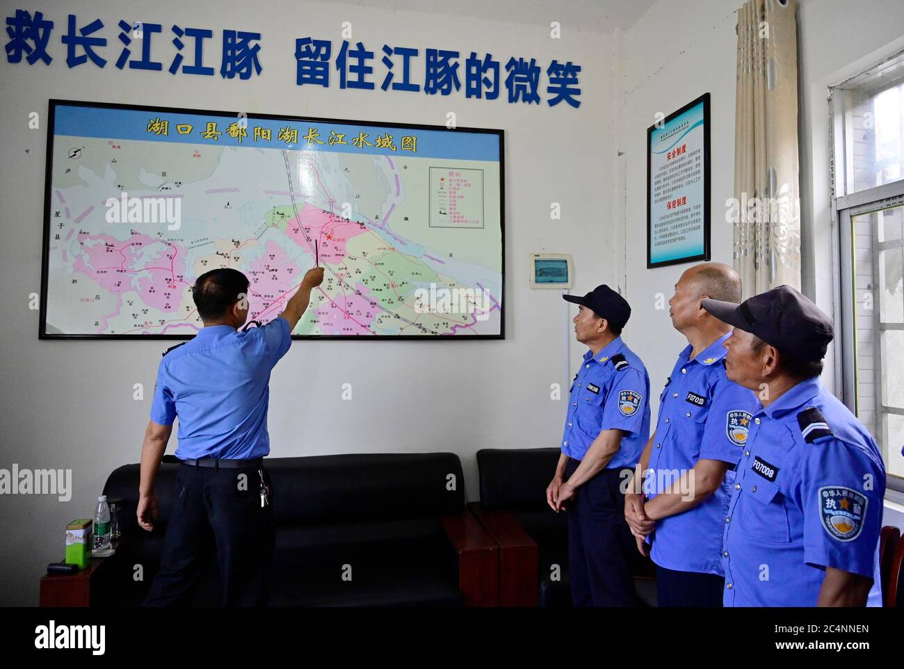 (200628) -- NANCHANG, June 28, 2020 (Xinhua) -- Members of a Yangtze finless porpoise protection team attend a mission briefing ahead of a daily patrol on the Poyang Lake in Hukou County, east China's Jiangxi Province, June 8, 2020. Eight of the 11 team members are fishermen-turned finless porpoise protectors who patrol the Poyang Lake on a daily basis. Their missions include dismantling illegal fishing facilities and preventing unlawful activities that damage the Poyang Lake's fisheries resources. China began a 10-year fishing moratorium from the beginning of this year in 332 conservation are Stock Photo