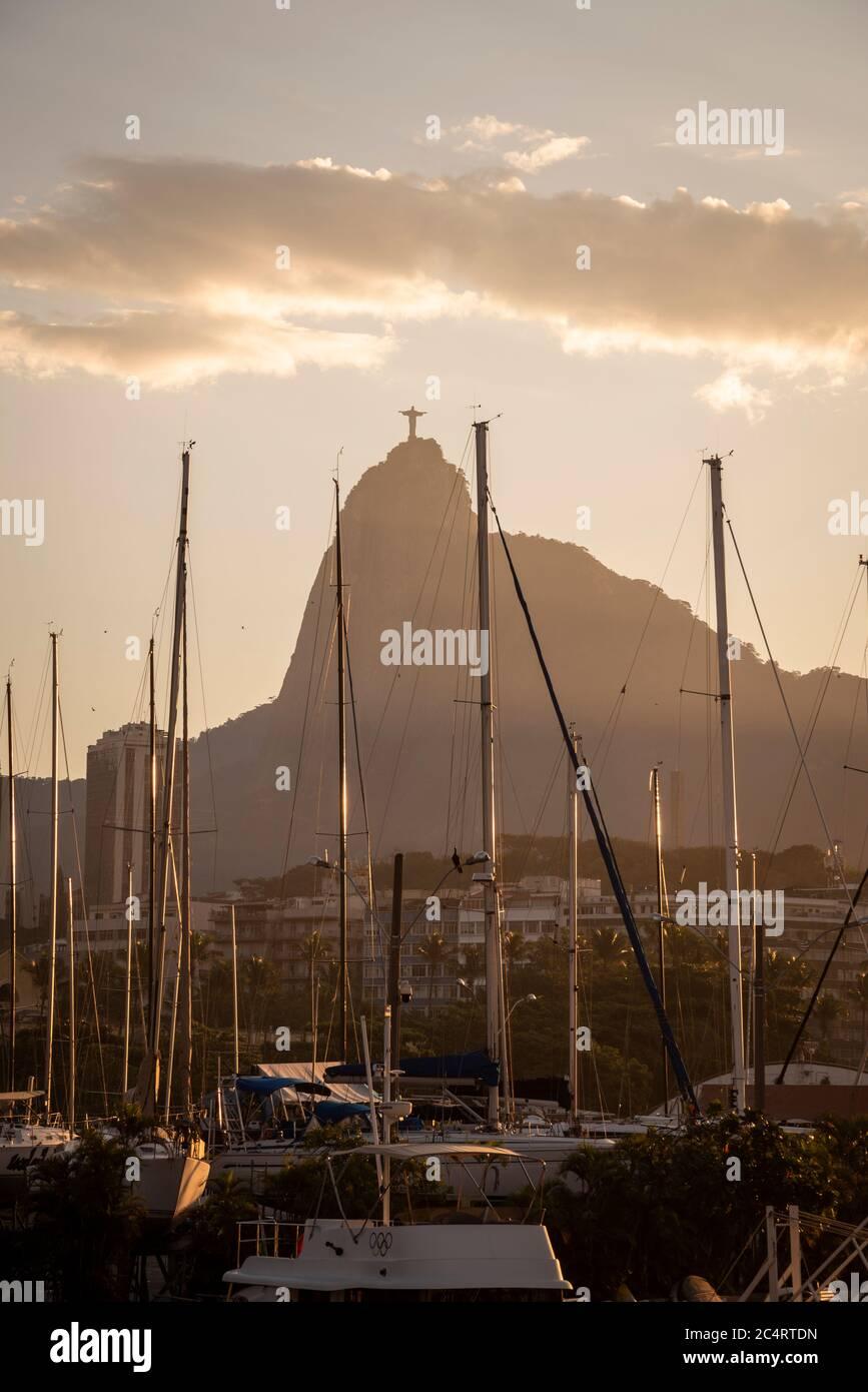 Beautiful view to Corcovado Mountain behind sailboat masts, Rio de Janeiro, Brazil Stock Photo
