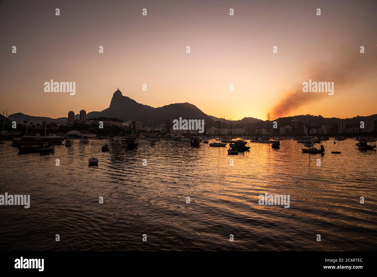 Beautiful view to ocean, Corcovado Mountain and Christ the Redeemer Statue during sunset, Rio de Janeiro, Brazil Stock Photo