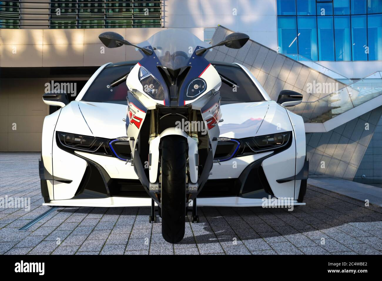 Bmw S1000rr Motorcycle Versus Bmw I8 Electric Sports Coupe Stock Photo Alamy
