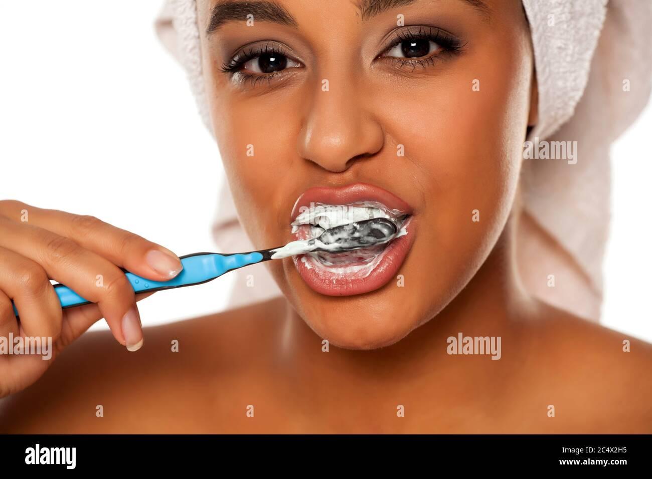 Busty Raquel Brushing Teeth