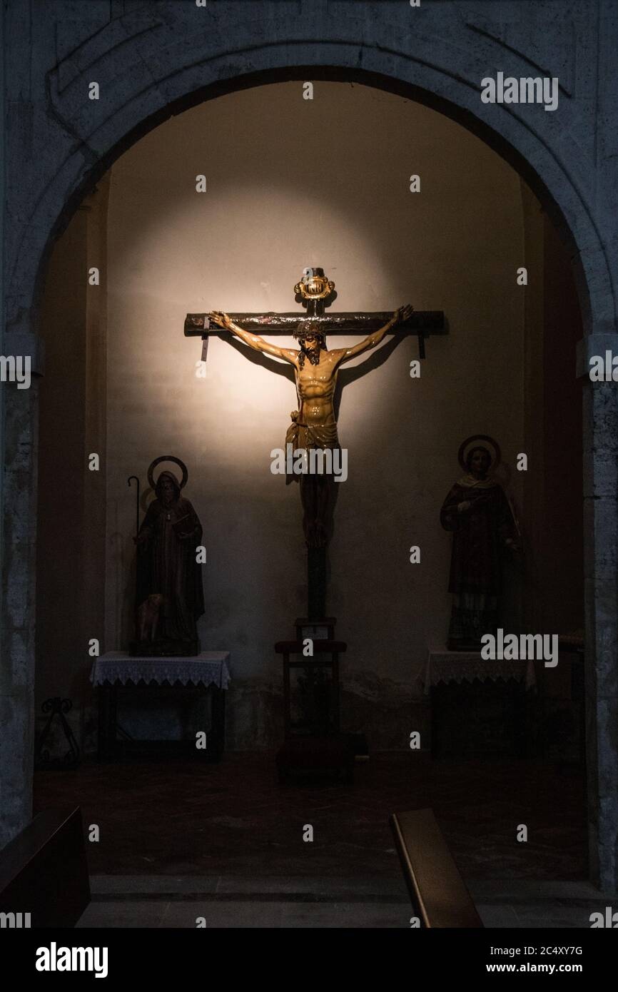 Crucifixion Statue in the Church of Our Lady of the Assumption, Chinchon, Madrid, Spain Stock Photo
