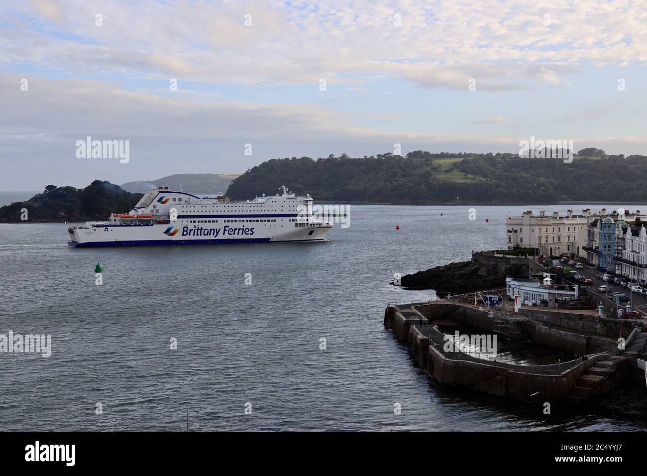 """Plymouth, UK. 29th July, 2020. Brittany Ferries """"Armorique"""" returns to Plymouth for the first time since March, when sailings were cancelled due to Coronavirus. The ship is scheduled to make its first return sailing from Plymouth to Roscoff, France, at 22:00 tonight. Credit: Julian Kemp/Alamy Live News Stock Photo"""