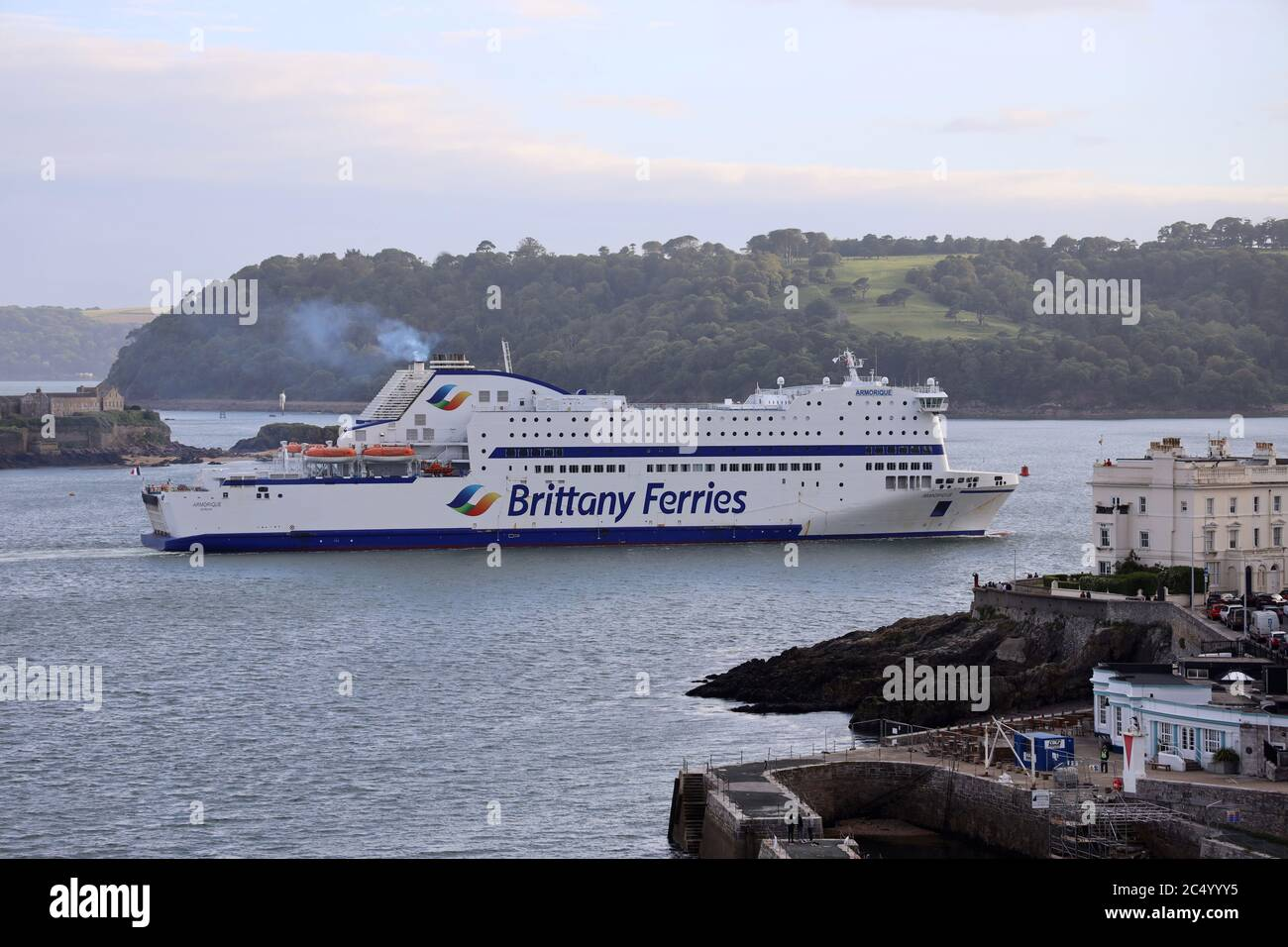 "Plymouth, UK. 29th July, 2020. Brittany Ferries ""Armorique"" returns to Plymouth for the first time since March, when sailings were cancelled due to Coronavirus. The ship is scheduled to make its first return sailing from Plymouth to Roscoff, France, at 22:00 tonight. Credit: Julian Kemp/Alamy Live News Stock Photo"