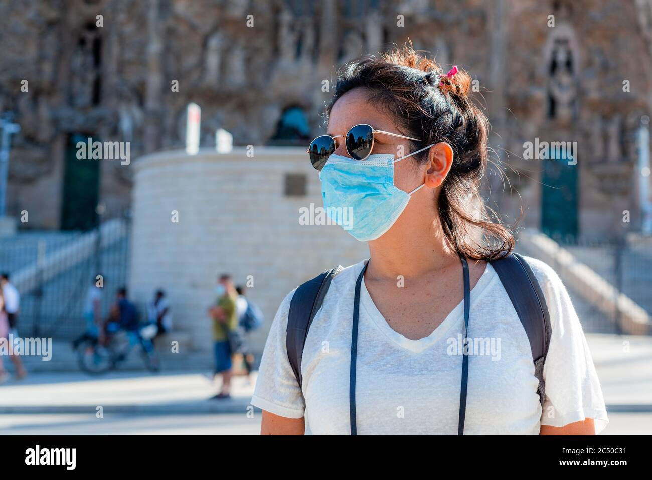 young tourist wearing face mask sightseing in european city. traveling and tourism industry during the corona virus pandemic and covid19 disease, affe Stock Photo