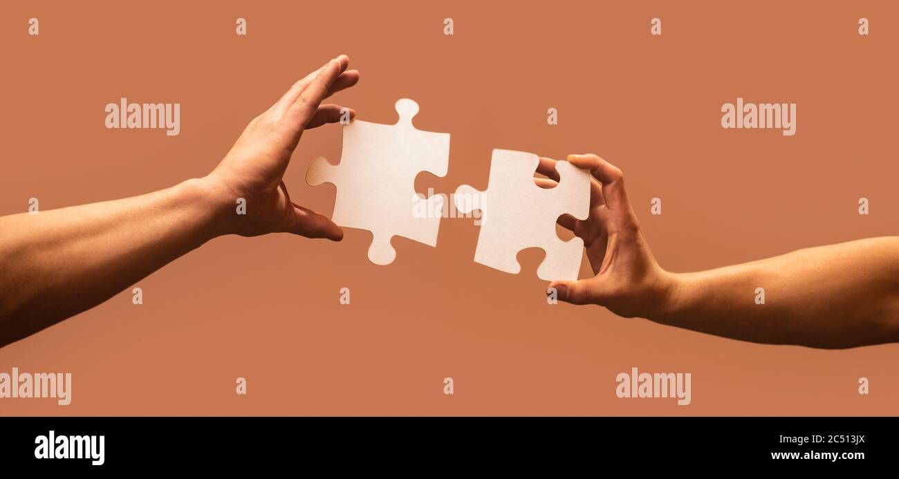 Business solutions, success and strategy concept. Man hands connecting couple puzzle piece. Business solutions, target, success, goals and strategy Stock Photo
