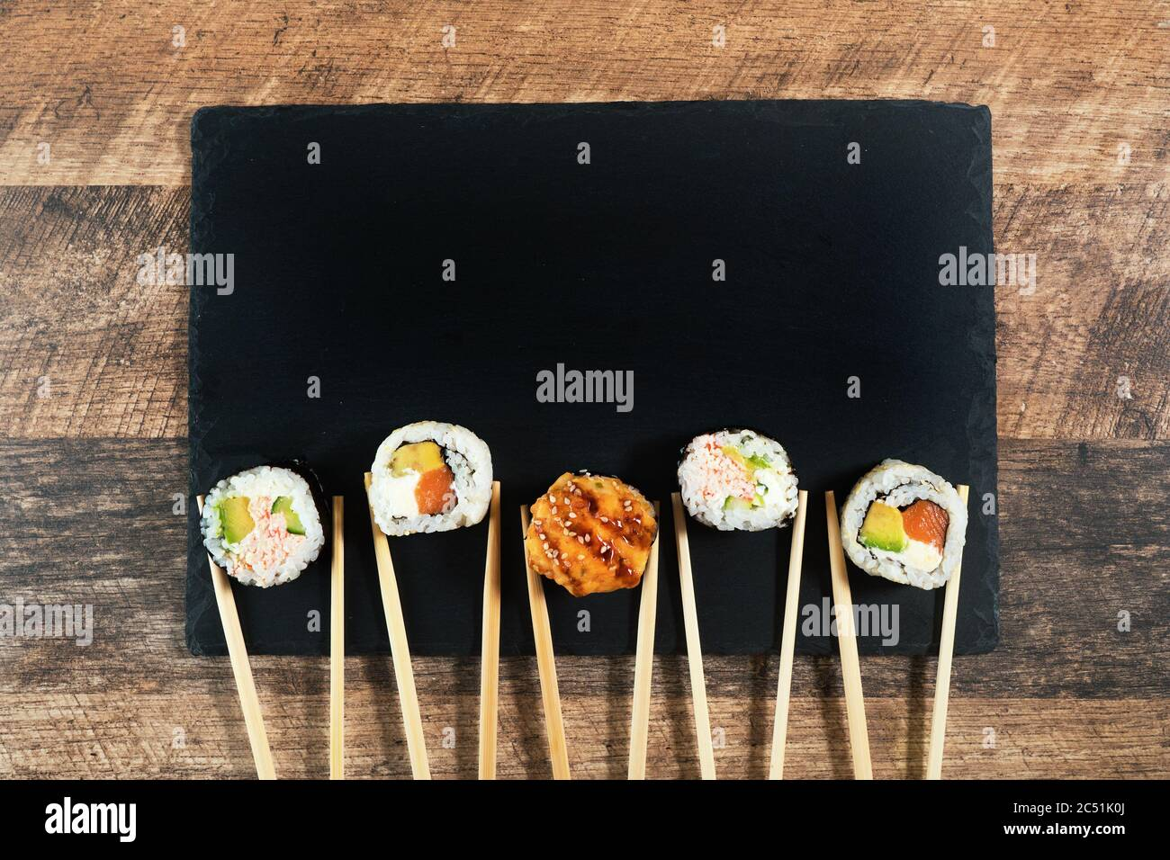 Sushi roll set with chopsticks. Place for your text or logo. Stock Photo