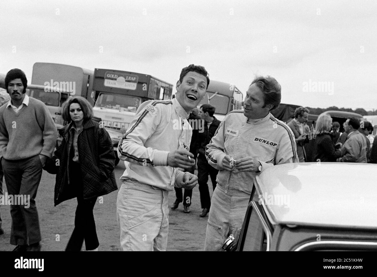 The late Barrie Williams in conversation with fellow mini racer John Rhodes at Brands Hatch in 1969.  Guards International Trophy Meeting. Stock Photo