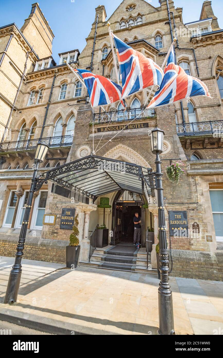Ian, one of the management team, cleans front door handles at The Randolph Hotel, Oxford, ready to reopen after the Covid-19 lockdown on July 4th 2020 Stock Photo