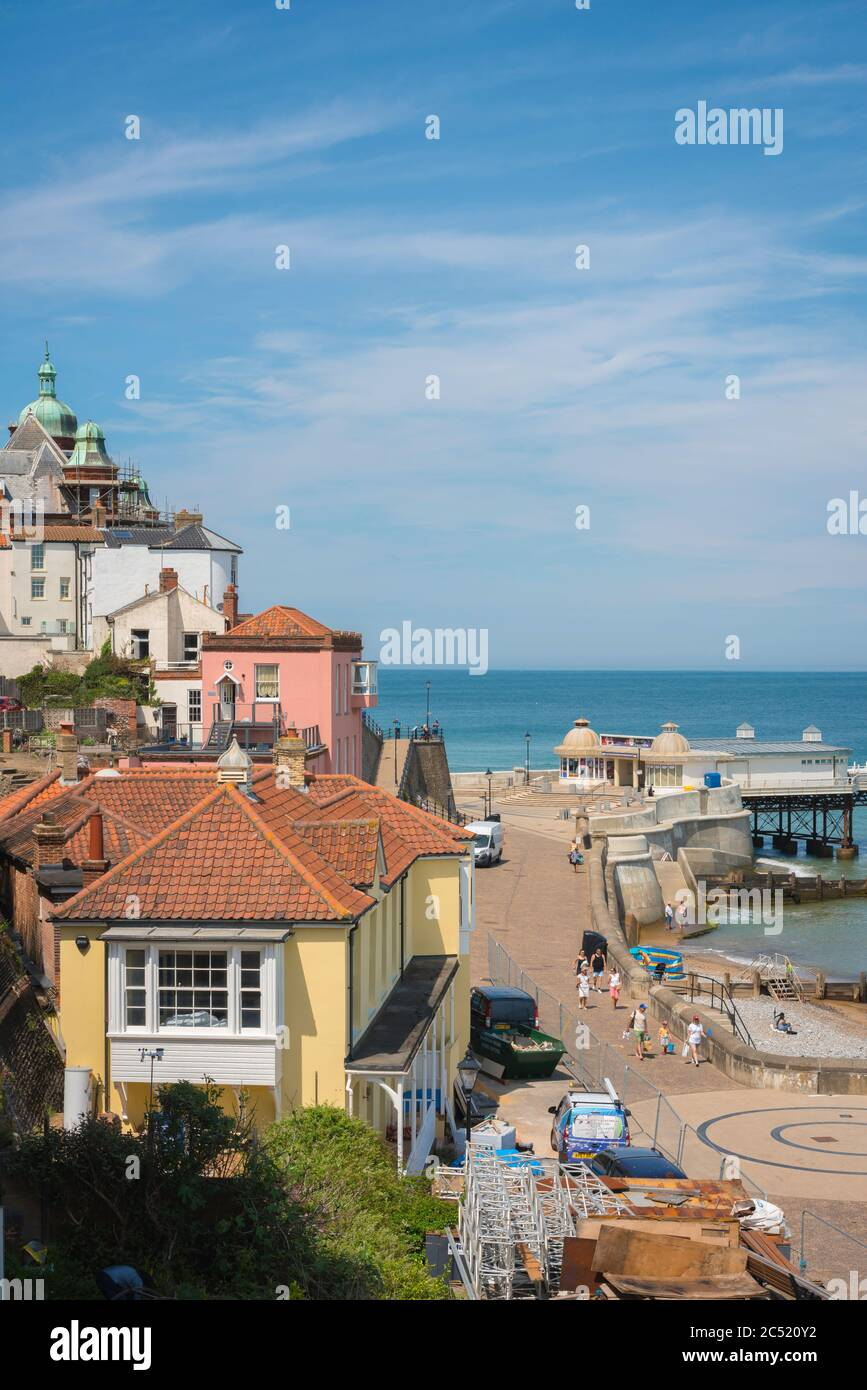 Traditional British seaside town, view in summer of the esplanade and Edwardian era pier in the seaside town of Cromer, Norfolk, England, UK Stock Photo