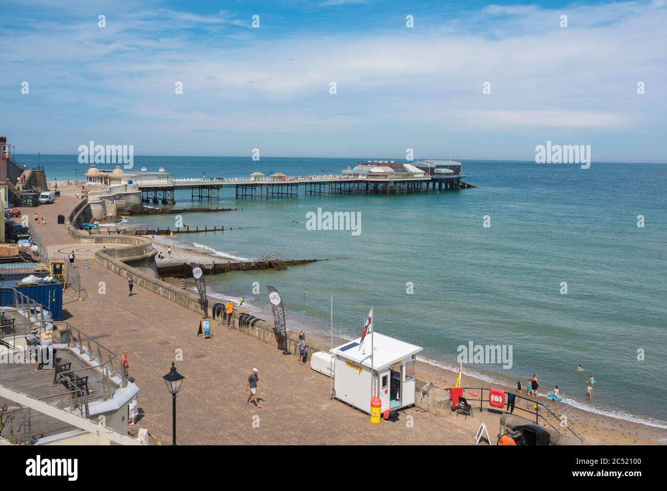 Traditional English seaside town, view in summer of the esplanade and Edwardian era pier in the seaside town of Cromer, Norfolk, England, UK Stock Photo