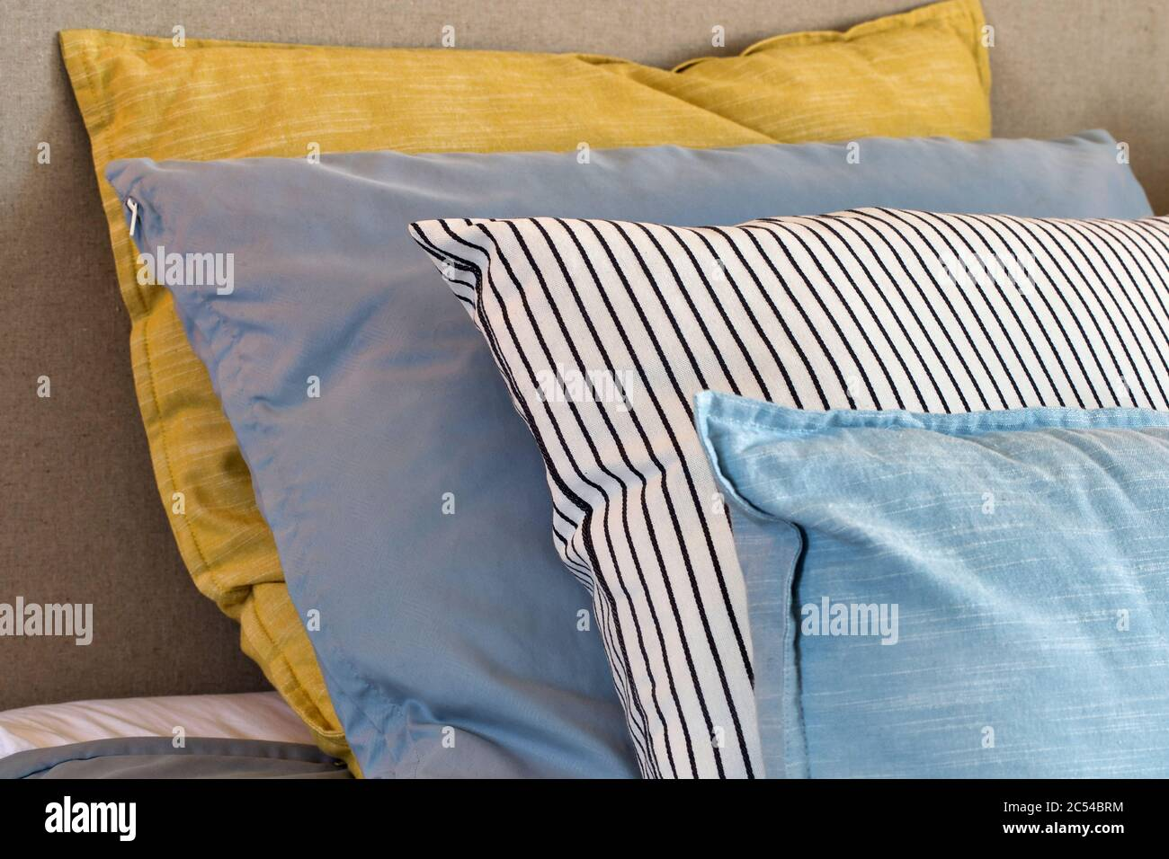 Closeup Of Yellow And Light Blue Pillows In A Row On The Bed Modern Retro Decoration For Home Pastel Light Colors Colorful Bright Stock Photo Alamy