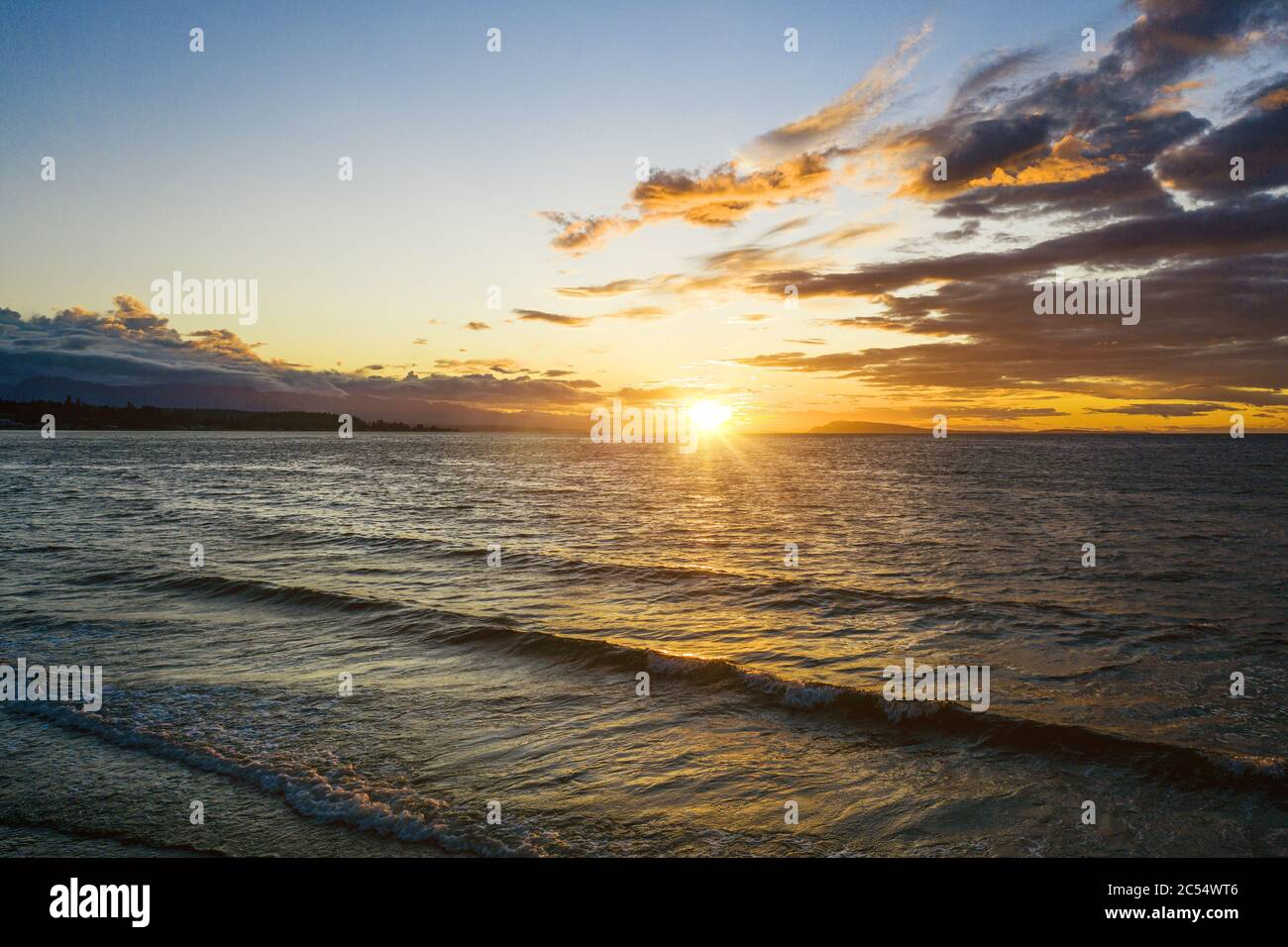Sun Touching Horizon During Beautiful Sunset At The Beach Water And Relaxation Golden Hour Background Wallpaper Stock Photo Alamy