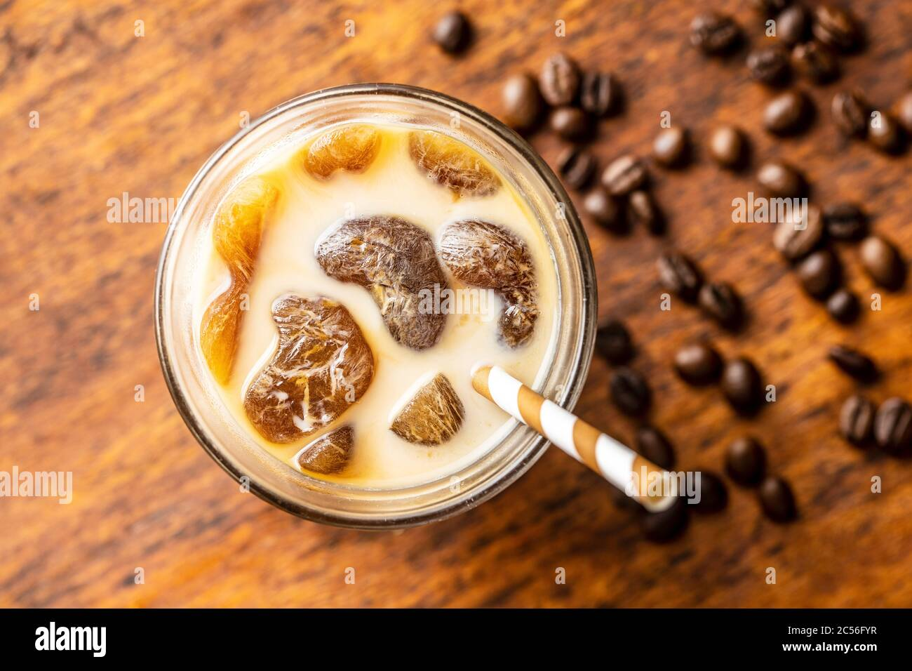 Iced Coffee With Coffee Ice Cubes On Wooden Table Top View Stock Photo Alamy
