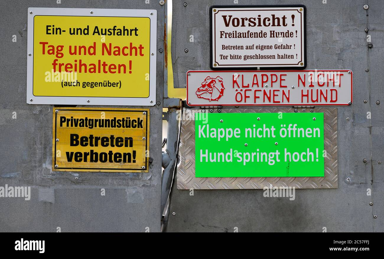 Various signs warn of entering the property, Stuttgart, Baden-Württemberg, Germany Stock Photo