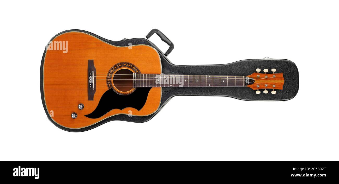 Musical instrument - Vintage western guitar from above on a hard case isolated on a white background. Stock Photo
