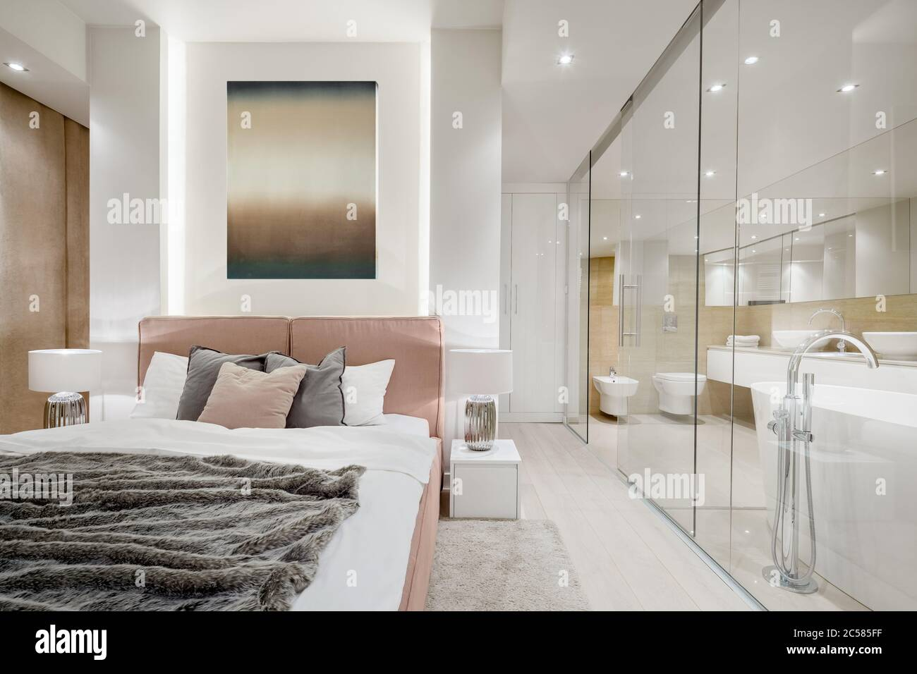 Luxury Master Bedroom With Double Bed Next To Elegant Bathroom Behind Glass Wall Stock Photo Alamy