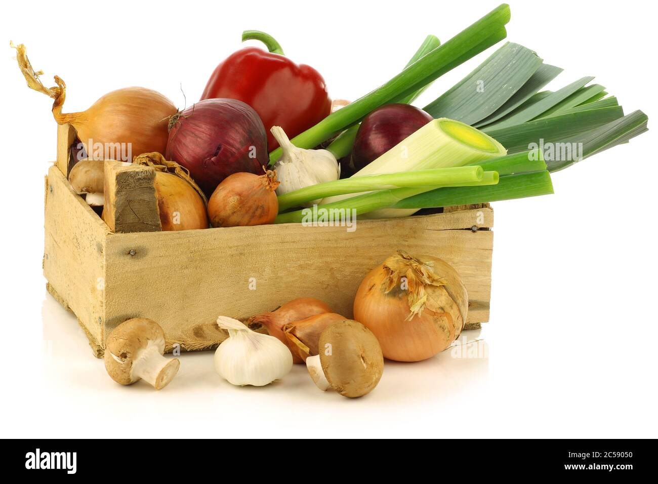 fresh assorted vegetables in a wooden crate on a white background Stock Photo