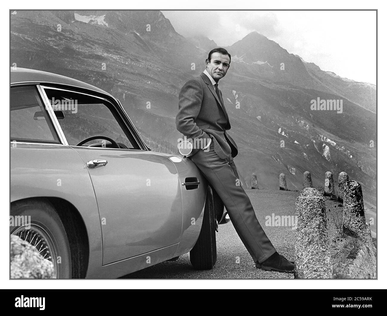 Goldfinger 1964 James Bond Aston Martin Db5 Sean Connery In The Swiss Alps With The Aston Martin Db5 From The James Bond 007 Film Movie Goldfinger 1964 Connery With An Aston Martin