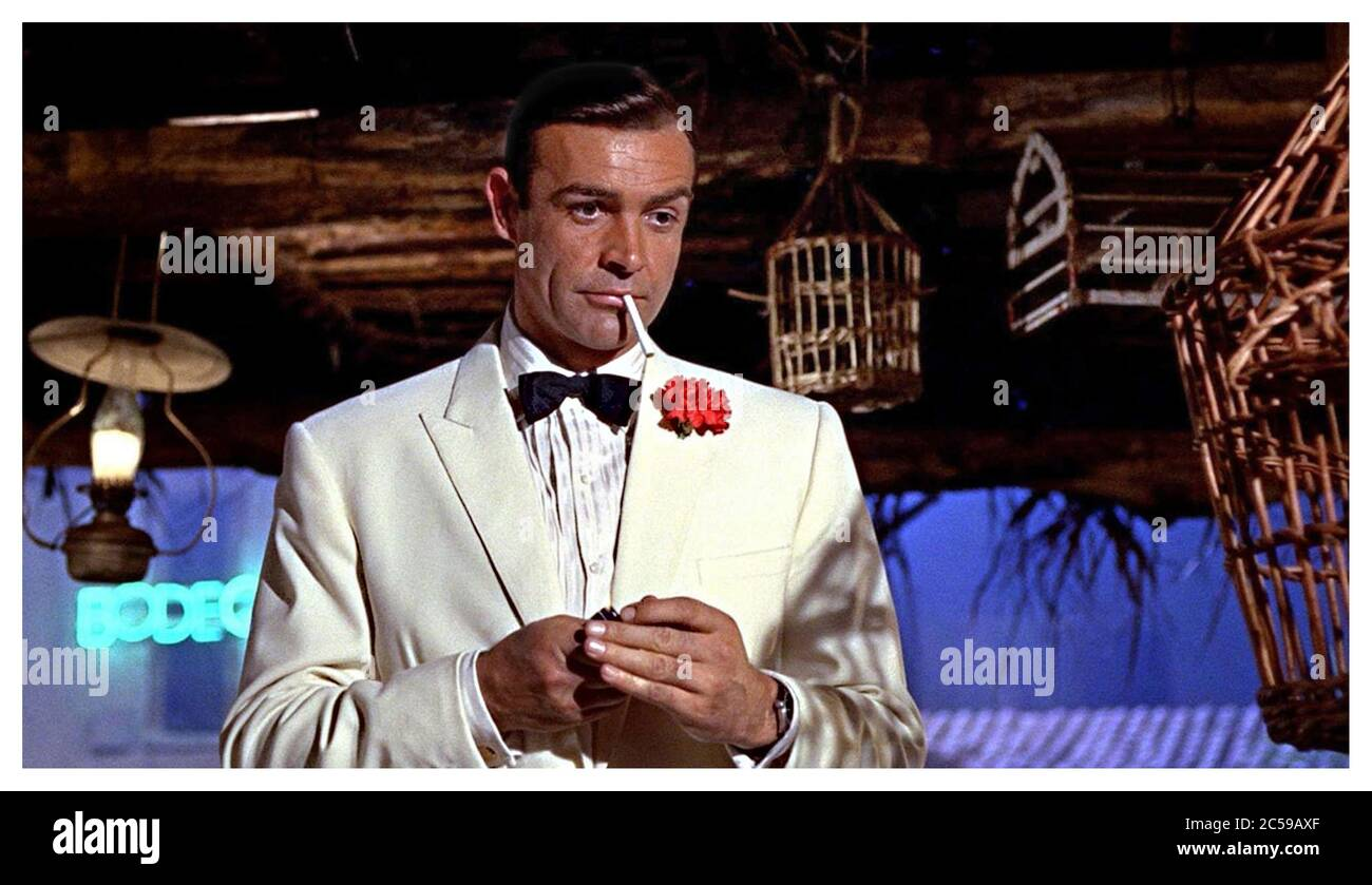 Goldfinger 1964 007 James Bond Played By Sean Connery In White Dinner Jacket Lights His Cigarette British Government Secret Agent And Spy Stock Photo Alamy