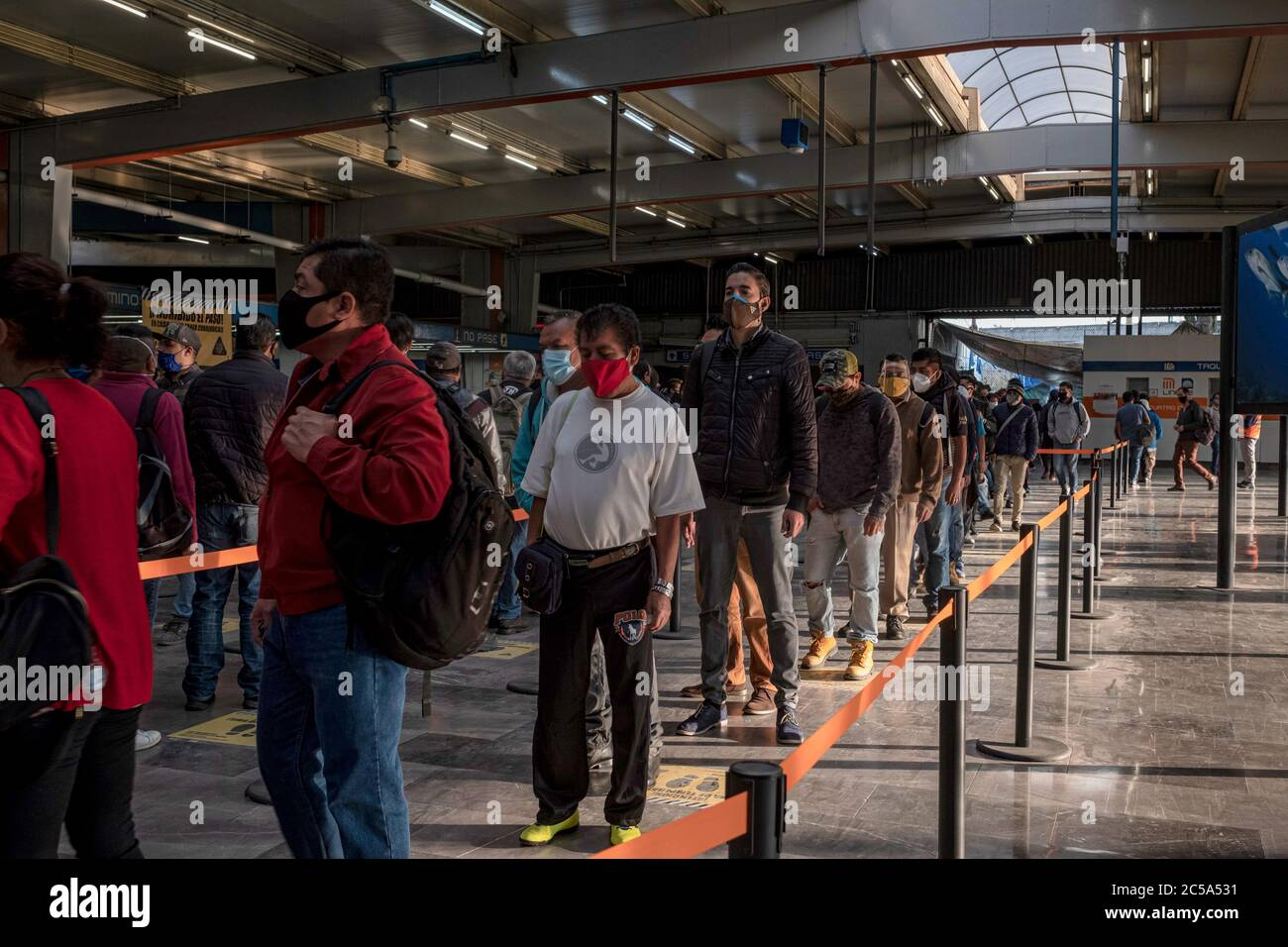 Mexiko Stadt, Mexico. 01st July, 2020. People wearing face masks are queuing in a subway station in the middle of the corona pandemic. Commuters now have to wear a mask, their hands are sprayed with disinfectant before using transport. The Mexican government has confirmed 226,089 Covid-19 infected and 27,769 coronavirus deaths. Credit: Jacky Muniello/dpa/Alamy Live News Stock Photo