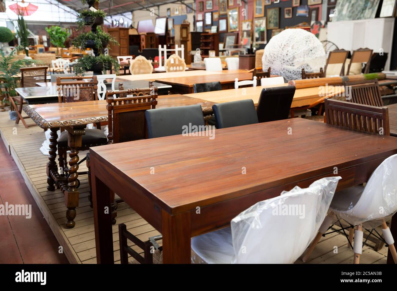 Wooden Tables Chairs And Other Furniture Offered For Sale In Store Stock Photo Alamy