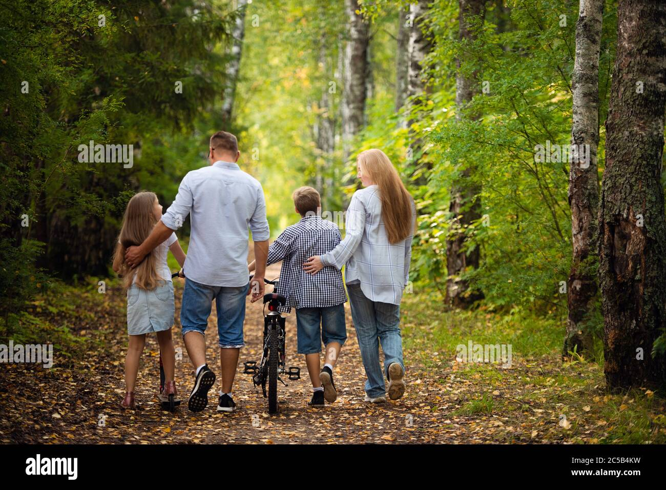 Happy family outdoors smiling in a summer forest Stock Photo