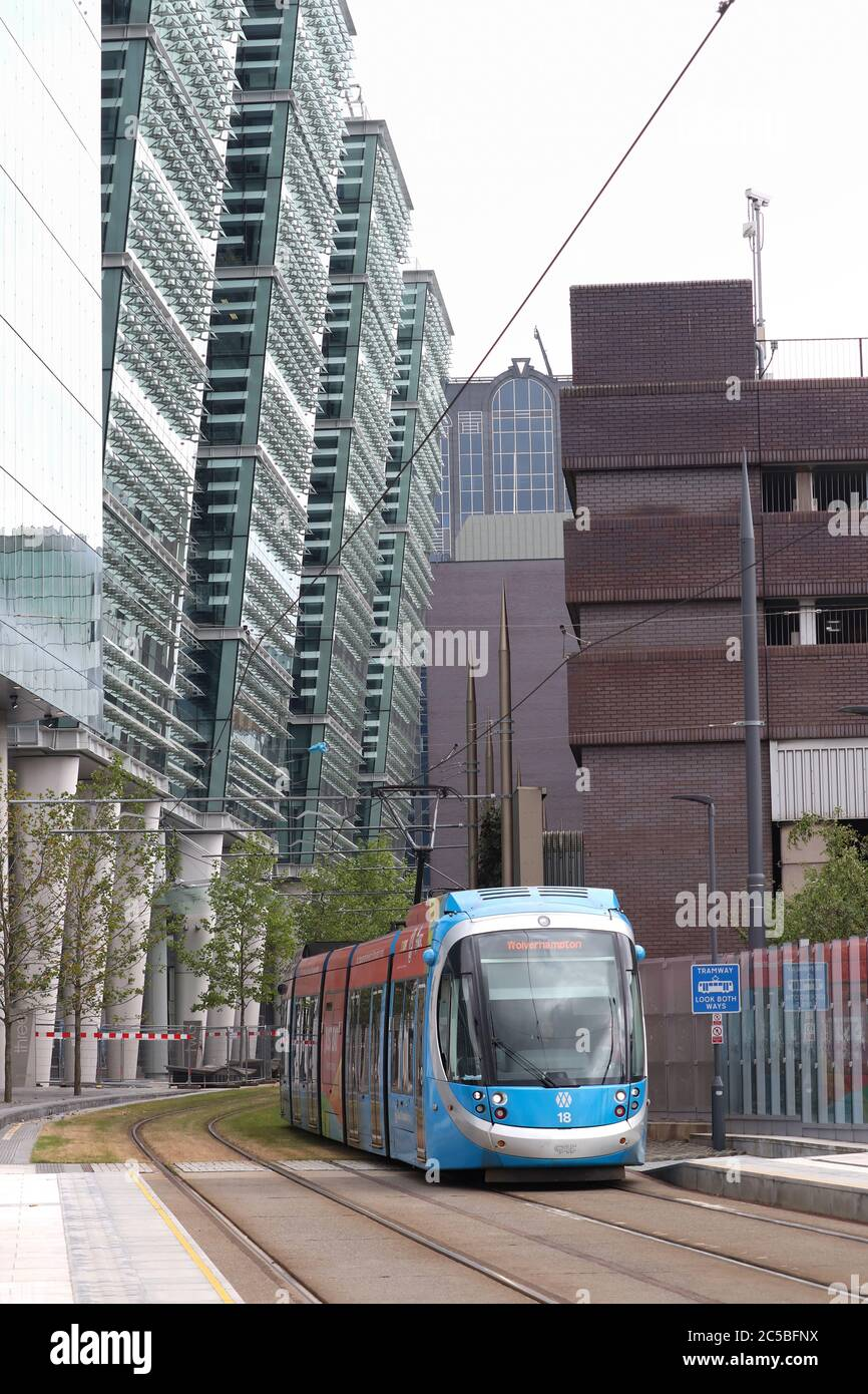 A metro tram passing through the new Snowhill development in the centre of Birmingham. The tram/metro is about to arrive at  St Chads metro station a new station opened on 2020. Snowhill 3 was completed in 2020 completing the development to the left of the picture. Stock Photo