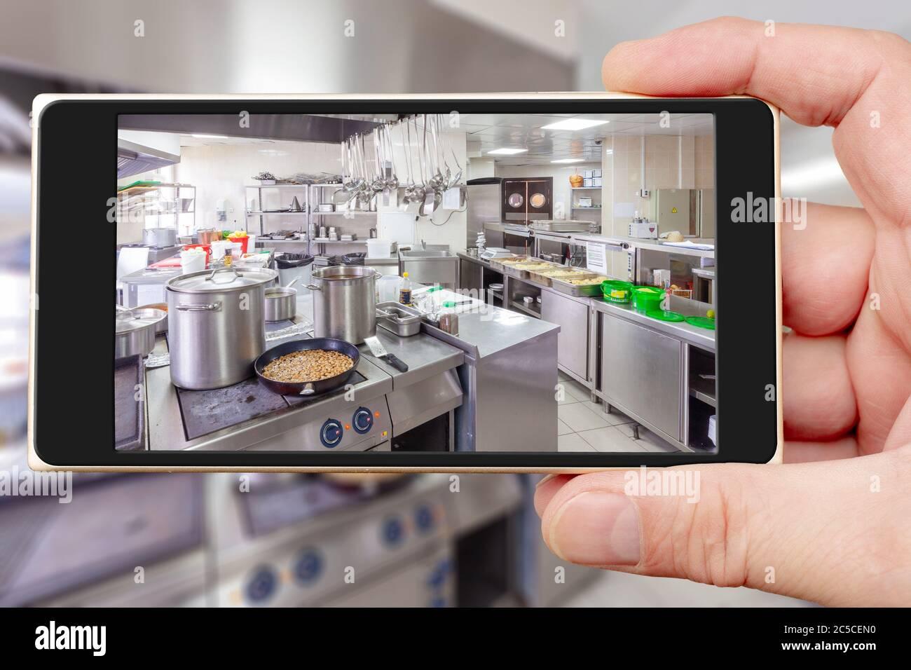 Restaurant Kitchen On Smartphone Screen Chrome Kitchen Equipment Cafe Stock Photo Alamy