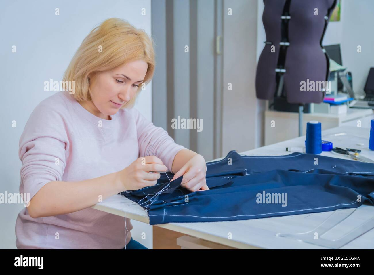 Professional Tailor Fashion Designer Sitting And Working At Sewing Studio Preparation Process Fashion And Tailoring Concept Stock Photo Alamy