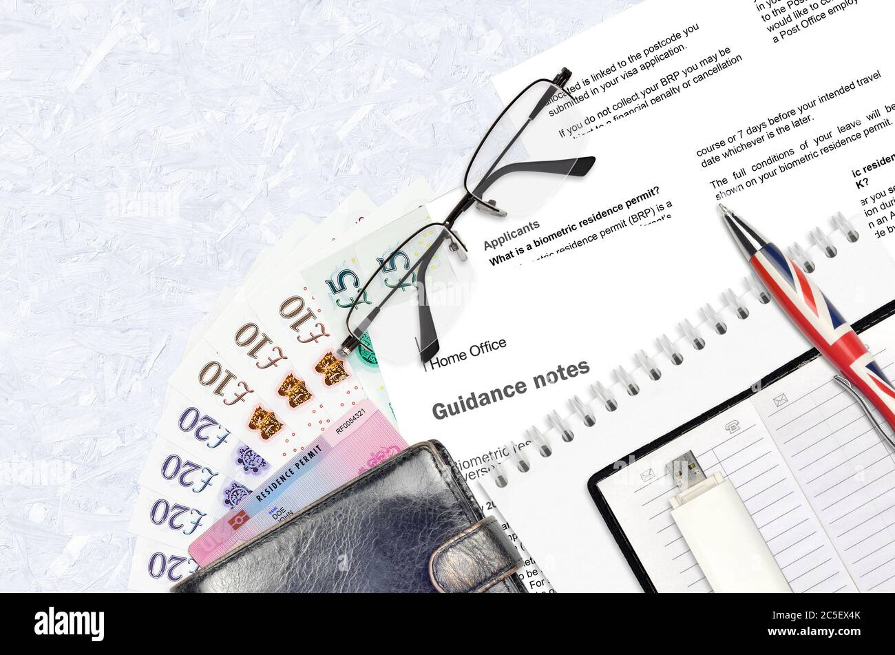 English Form Brp With Guidance Notes To Applying Biometric Residence Permit Card From Uk Visas And Immigration Services Lies On Table With Office Item Stock Photo Alamy