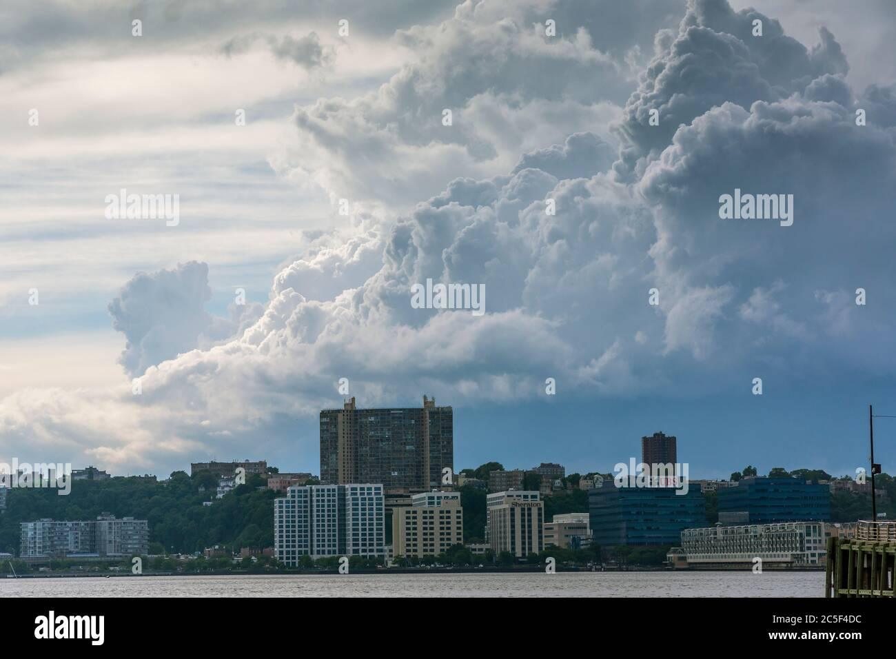 Clouds above Hobken, New Jersey seen from Hudson River Park in New York on Saturday, June 27, 2020 Stock Photo