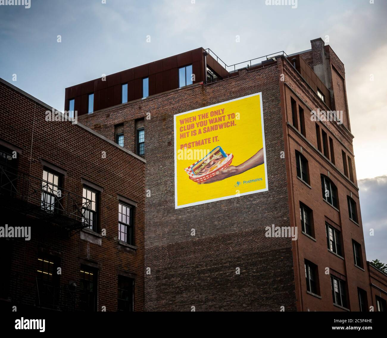 An advertisement for the Postmates delivery service in the trendy Meatpacking District in New York on Wednesday July 1, 2020. Uber is reported to have made an offer to buy Postmates.  (© Richard B. Levine) Stock Photo
