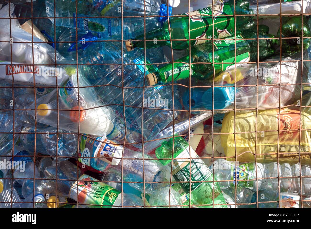 Full container of plastic household waste for recycling Stock Photo