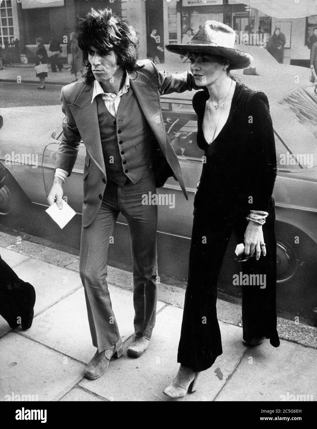 Oct. 24, 1973 - London, England, United Kingdom - KEITH RICHARDS, the guitarist of the famous British rock group The Rolling Stones, and his girlfriend ANITA PALLENBERG on their way to court after both had been fined for drug offenses. (Credit Image: © Keystone Press Agency/Keystone USA via ZUMAPRESS.com) Stock Photo