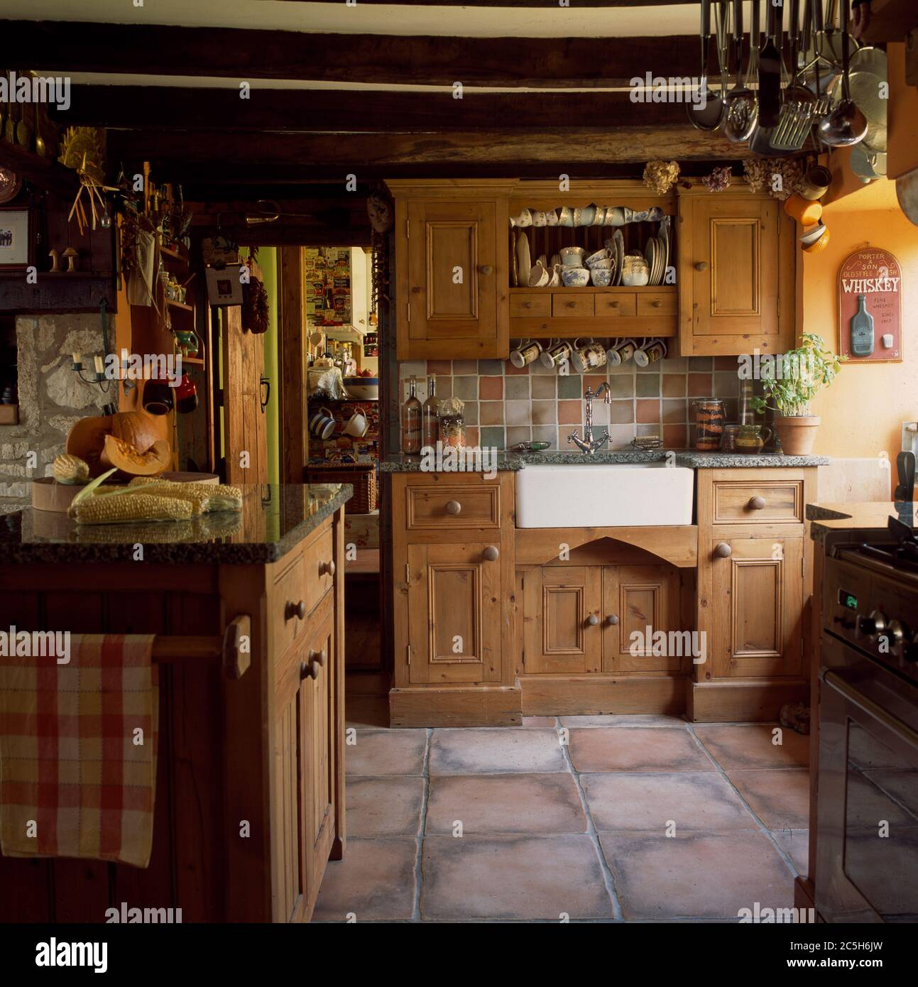 Small Cottage Kitchen With Wooden Units And Tiled Floor Stock Photo Alamy