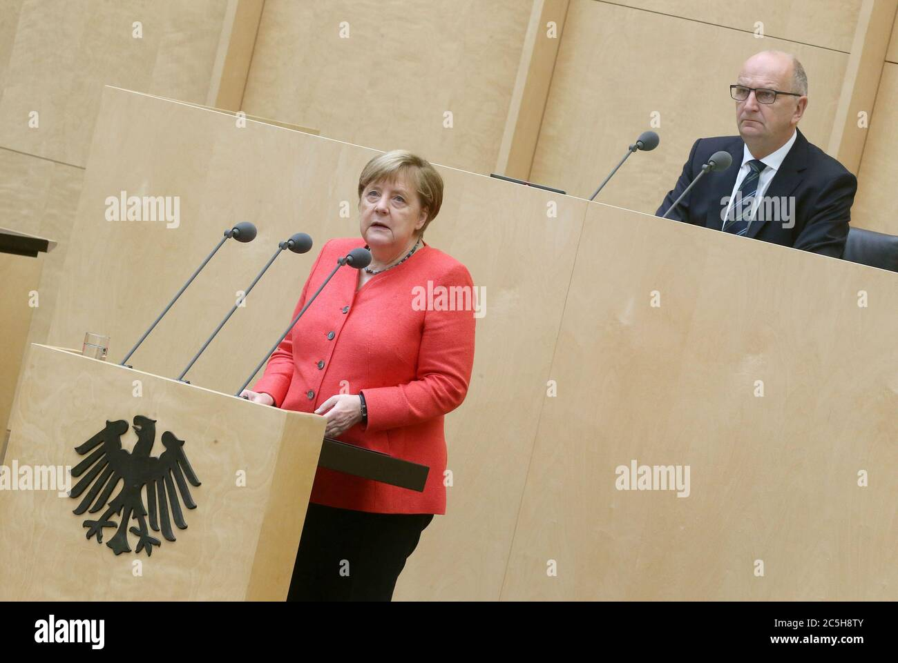 Berlin, Germany. 03rd July, 2020. Chancellor Angela Merkel (CDU) gives a speech in the Bundesrat on the objectives of the EU Council Presidency. Dietmar Woidke (SPD), President of the Bundesrat, follows the speech. Credit: Wolfgang Kumm/dpa/Alamy Live News Stock Photo