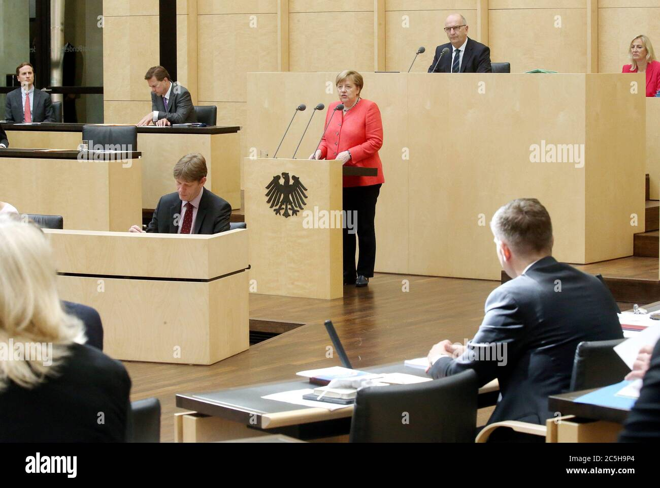 Berlin, Germany. 03rd July, 2020. Chancellor Angela Merkel (CDU, M) gives a speech in the Bundesrat on the objectives of the EU Council Presidency, Dietmar Woidke (SPD, top, 2nd from right), President of the Bundesrat, follows the speech. Credit: Wolfgang Kumm/dpa/Alamy Live News Stock Photo
