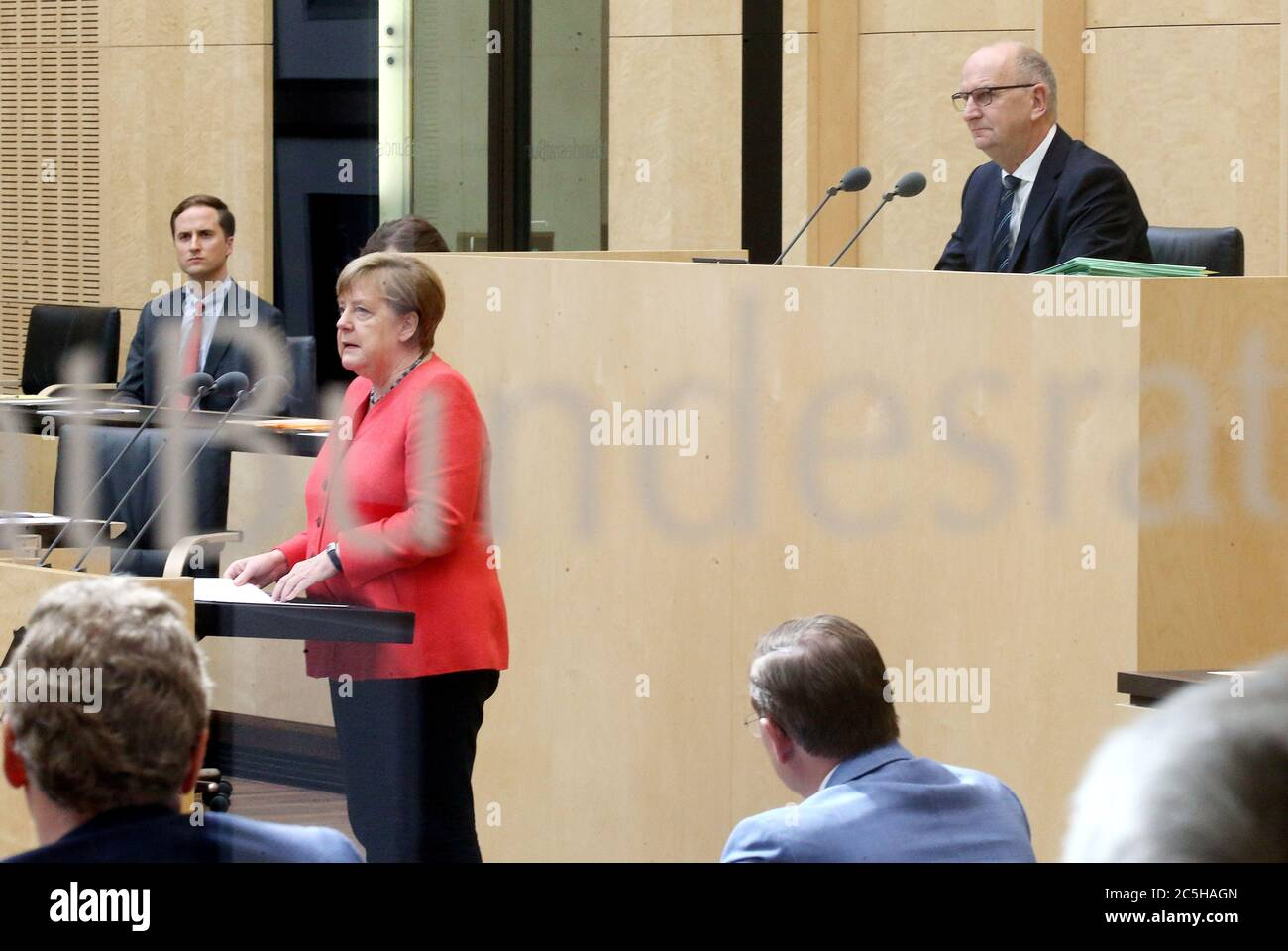 Berlin, Germany. 03rd July, 2020. Chancellor Angela Merkel gives a speech in the Bundesrat on the objectives of the EU Council Presidency, Dietmar Woidke (SPD, r), President of the Bundesrat, follows the speech. (Photographed through a window) Credit: Wolfgang Kumm/dpa/Alamy Live News Stock Photo