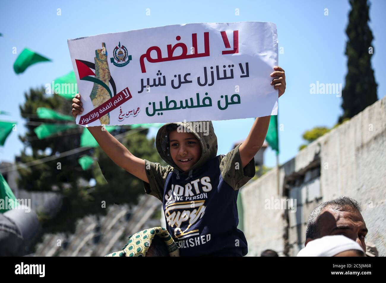 a kid holds a placard saying no for annexation during the protest thousands of palestinians protested alamy