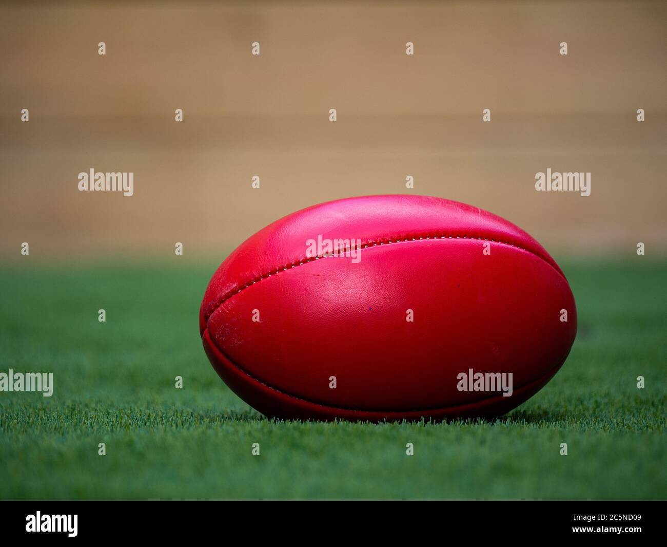 A Football on a Field all by itself, isolation Stock Photo
