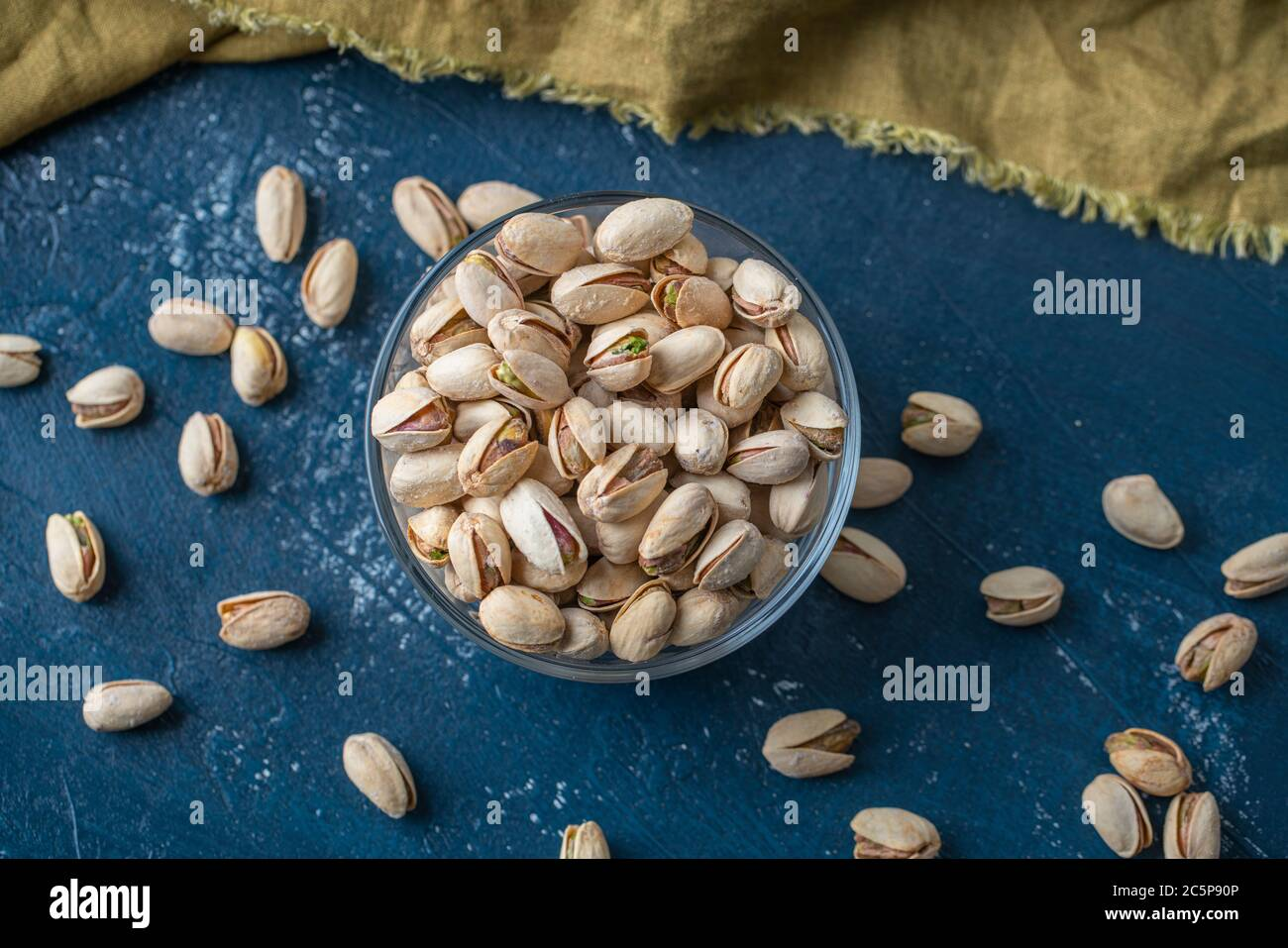 Roasted And Salted Pistachios In Glass Bowl Stock Photo